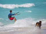 A Kiteboarder and His Dog Enjoying Gusty Winds from Hurricane Tomas Photographic Print by Mike Theiss