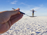 A Man Appears to Stand in a Spoon at the World Largest Salt Flats Photographic Print by Mike Theiss