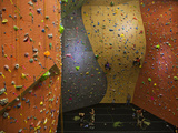 Climbers Ascend a Rock Wall at a Climbing Gym in Seattle Photographie par Michael Hanson