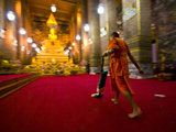 A Buddhist Monk Vacuums the Chapel's Red Carpet after Evening Prayer Photographic Print by Jason Edwards
