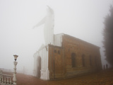 Thick Fog Engulfing the Santuario De Guadalupe Christ Statue Photographic Print by Mike Theiss
