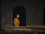 A Monk Out from the Windows of a Wooden Monastery in Myanmar Photographic Print by Alex Treadway