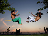 Two Young Brazilian Men Practice Capoeira in a NY Park at Sunset Photographic Print by Pete McBride