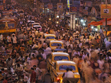 Kolkata's Streets Crammed with Vendors, Pedestrians, and Taxis Photographic Print by Randy Olson