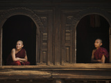 Monks Look Out from the Windows of a Wooden Monastery in Myanmar Photographic Print by Alex Treadway