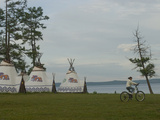 A Young Mongolian Rides Her Mountain Bike Past a Tourist Ger Camp at Toilogt Photographic Print by Gordon Wiltsie