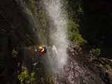 A Canyoneer Descends Through One of Kanangra Main's Waterfalls Photographic Print by Peter Carsten