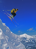 A Skier Jumps a Cornice at Exclusive Yellowstone Club Ski Area, Montana Photographic Print by Gordon Wiltsie