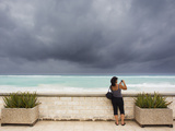 Tourists Come to the Beach to See Hurricane Igor's First Outer Bands Photographic Print by Mike Theiss
