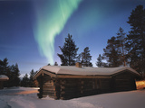 Aurora Borealis over Log Cottages in Arctic Finland Photographic Print by Diane & Len Cook & Jenshel