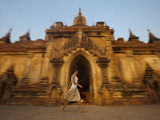 A Tourist Walks Past One of the Ancient Temples at Bagan Photographic Print by Alex Treadway