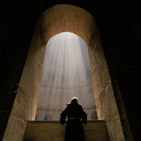 A Franciscan priest gazes at the Tomb of Christ in Jerusalem's Church of the Holy Sepulchre. Photographic Print by Lynn Johnson
