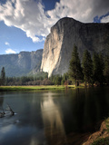 El Capitan Rises Above the Merced River Photographic Print by Raul Touzon