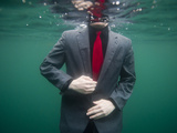 A Teenage Boy Swims in a Suit Along the Coast of Fernandina Island Photographie par Joel Sartore