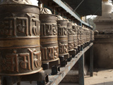 Prayer Wheels Near a Stupa in Kathmandu, Nepal Photographic Print by Greg Winston