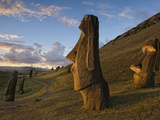 A Path Winds Past Moai Spread across Rolling Hills Photographic Print by Jim Richardson