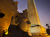 A Massive Head of Ramses Ii Flanks the Entrance Gate to the Temple at Luxor. Photographic Print by Michael Melford