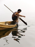 A Man Pulls in His Net on Indawgyi Lake, Northern Myanmar Photographic Print by Alex Treadway
