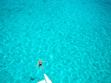 A Woman Leaps from a Yacht into the Caribbean Sea Photographic Print by Heather Perry