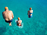 Three Open Water Swimmers Jumping into the Water Photographic Print by Heather Perry