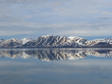Snow and Mountains Reflected in Still Arctic Water Photographic Print by Alison Wright