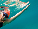 A Woman Open Water Swimming, Viewed from Underneath Photographic Print by Heather Perry