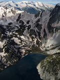 An Aerial View over a Lake High in the Snow-Capped Elk Mountains Photographic Print by Pete McBride