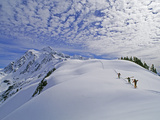 Off-Piste Skiers Hike Below Mount Shuksan, Near Mount Baker Ski Area Photographic Print by Gordon Wiltsie