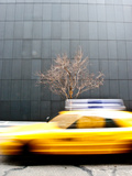 A Taxi Passes by in a Blur Photographic Print by Jorge Fajl