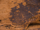 Ancient Native American Petroglyphs on a Sandstone Cliff Photographic Print by James Forte