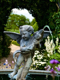 A Sculpted Fountain of a Boy with a Fish in a Castle Garden Lámina fotográfica por Heather Perry