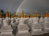 Rainbows Arc Above Chortens at a Buddhist Festival Photographic Print by Michael S. Yamashita