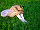 A Ballerina Rests in the Grass Near the Panama Canal Photographic Print by Kike Calvo
