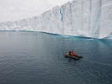 People in an Inflatable Boat Exploring an Ice Shelf Photographic Print by Bob Smith