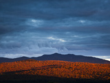 Sunset Light Stretches Toward Moose Mountain Photographic Print by Michael Melford