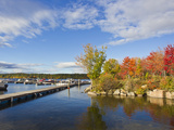 Brilliantly Colored Trees on a Lake Shore During Autumn Photographic Print by Mike Theiss