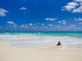 Woman Enjoys a Perfect Beach Day of Clear Skies and Blue Waters Photographic Print by Mike Theiss