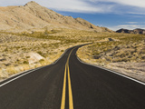 A Road Through and Arid Desert Landscape Photographic Print by James Forte