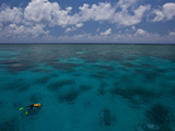 A Lone Snorkeler on the Water at the Great Barrier Reef Photographic Print by Michael Melford