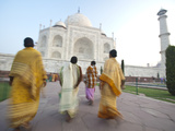 Women in Traditional Dress Approach the Taj Mahal Photographic Print by Michael Melford