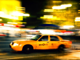 A NY Taxi Cab Rushes By Photographie par Jorge Fajl