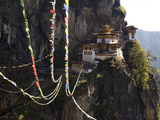 Prayer Flags Sway in the Wind Near Taktsang Monastery Photographic Print by Alison Wright