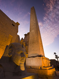 An Obelisk and Sphinx Head at the Entrance to Luxor Temple Photographic Print by Michael Melford