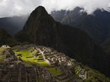 Sunlight Strikes Machu Picchu Through a Break in the Clouds Photographic Print by Michael Melford
