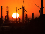 Sunset and Industrial Plants Photographic Print by Bodo Ulmenstein