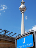 Berlin Television Tower and Metro Sign in Front of Blue Sky Photographic Print by Synchropics