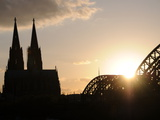 Silhouette of the Cologne Cathedral and the Hohenzollernbrücke Photographic Print by Erich Haefele