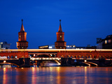 Berlin Oberbaumbrücke Bridge with Passing Orange Subway Train by Night. Vibrant Colors and Long Tim Photographic Print by Synchropics
