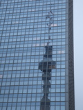 Transmission Tower Is Reflected in Park Inn Hotel Photographic Print