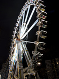 Ferris Wheel at Night in an Amusement Park Photographic Print by  Synchropics